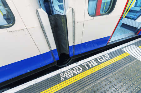 Famous Mind The Gap sign in London underground station.