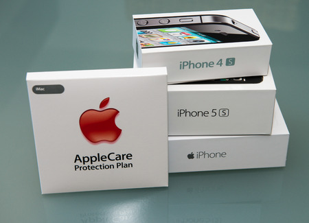 4s: PISA, ITALY - NOVEMBER 19, 2014: Iphones 4s, 5s and 6plus with apple care boxes. Apple care is a warranty extension for three years. Editorial