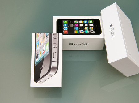 PISA, ITALY - NOVEMBER 19, 2014: Iphone 4s, 5s and 6plus original boxes. Pre-orders of the iPhone 6 series exceeded 4 million within its first 24 hours of availability. Editorial