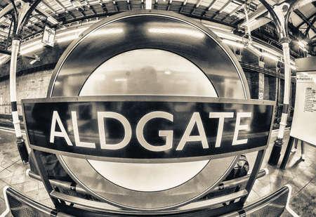 kilometres: LONDON - AUG 21, 2013: Aldgate underground subway sign. Underground system serves 270 stations and has 402 kilometres (250 mi) of track.