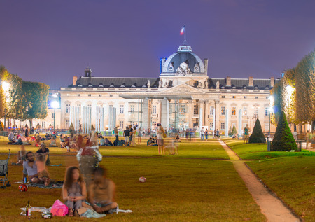 champs: Tourists in Champs de Mars on a wonderful summer night. Editorial