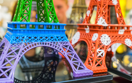 PARIS - JULY 20, 2014: Colourful miniatures of Eiffel Towers. The tower is the most visited monument in France.