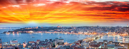 horns: Wonderful panoramic view of Istanbul at dusk across Golden Horn river.