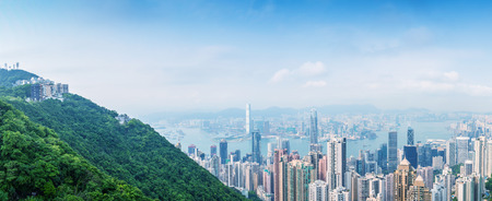 milion: HONG KONG - MAY 10, 2014: Hong Kong cityscape, aerial view. The city is a great tourist destination, visited by more than 35 milion people every year. Editorial
