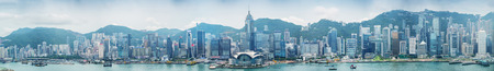 HONG KONG - MAY 12, 2014: Stunning panoramic view of Hong Kong Island skyline on a cloudy day. Last year HK hosted more than 54 million visitors, most of them from the mainland. Editorial