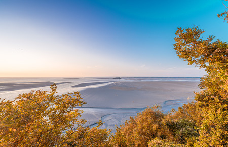 mont saint michel: Trees and sea view in Mont Saint Michel, Normandy, France. Stock Photo