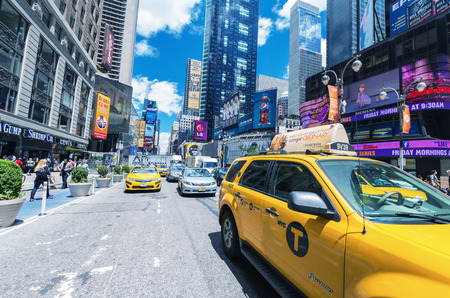 12 13: NEW YORK CITY - JUNE 12, 2013: Taxi cab in city street. The are more than 13,000 taxis in the city. Editorial