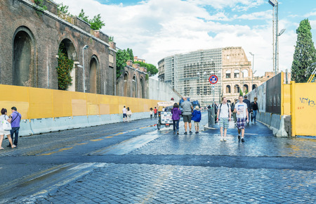 15 18: ROME - MAY 18, 2014: Tourists walk near Colosseum. More than 15 million people visit the city every year. Editorial