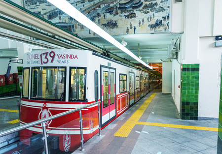 subterranean: ISTANBUL - OCTOBER 27, 2014: Istanbul tunnel train in Beyoglu. This one-stop funicular climbs the steeply uphill for 500 meters from Karakoy to Tunnel Square.