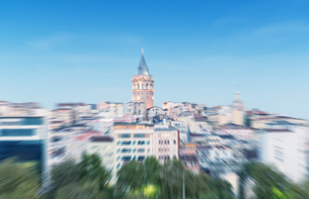 zoomed in: Blurred zoomed view of Galata tower and quarter in Istanbul.