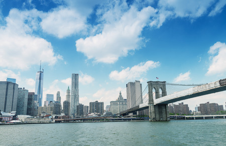 magnificence: Magnificence of Brooklyn Bridge and Manhattan skyline over East River.
