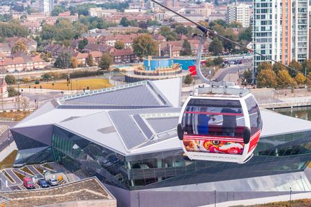 excel: LONDON - AUG 24: Visitors travel on the Emirates cable car. The service is London first urban cable car which crosses the Thames from Excel centre to the O2 on August 24, 2013 in London UK.