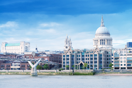 millennium bridge: Magnificence of Saint Paul Cathedral and Millennium Bridge, London. Stock Photo