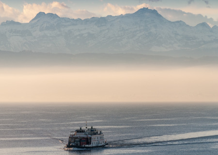 ferry boat: Ferry boat on a mountain lake with fog. Stock Photo