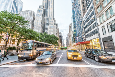 avenues: NEW YORK CITY - JUNE 8, 2013: Tourists and traffic on Fifth Avenue. The city is visited by more than 50 million people annually.