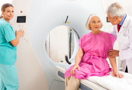radiotherapy: Mature female patient in 60s instructed by doctors about mri scan. Stock Photo