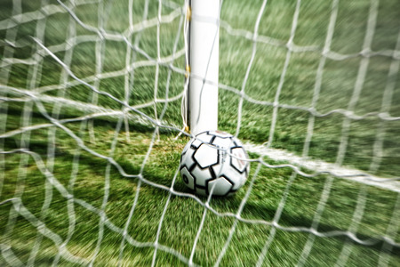goal line: Soccer ball inside the goal line.