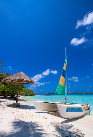 Catamaran over a wonderful tropical beach. photo