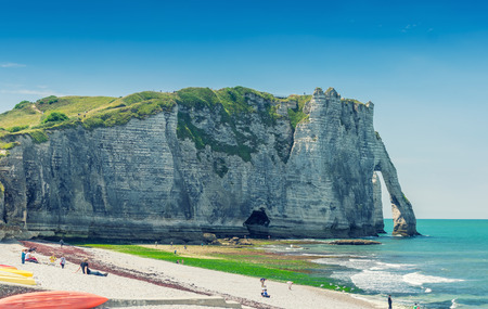 Etretat Aval cliff, rocks and natural arch landmark and blue ocean. Aerial view. Normandy, France, Europe. photo