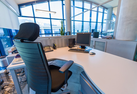 confortable: Modern office with confortable chair and desktop pc.