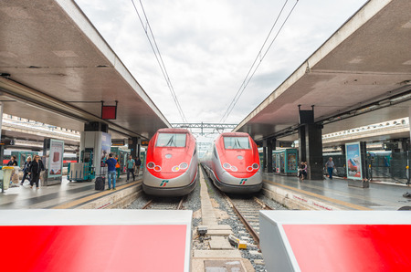 highspeed: ROME - JUNE 16, 2014: Termini train station and modern trains freccia rossa. Rome Termini is a major intersection in italian railway system.