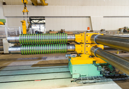 coils: Industrial machine for steel coils cut.