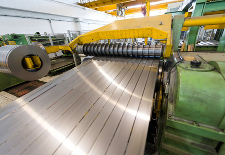 cutting: Machine for cutting steel coils.