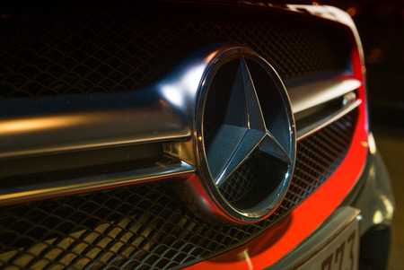 manufacturer: ANTWERPEN, BELGIUM - MAY 3, 2015: Mercedes Benz Sign Close-Up. Mercedes-Benz is a German automobile manufacturer. The brand is used for luxury automobiles, buses, coaches and trucks. Editorial