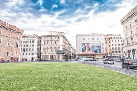 yea: ROME - MAY 20, 2014: Tourists and locals in Venice Square. The city is visited by more than 10 million people every yea.