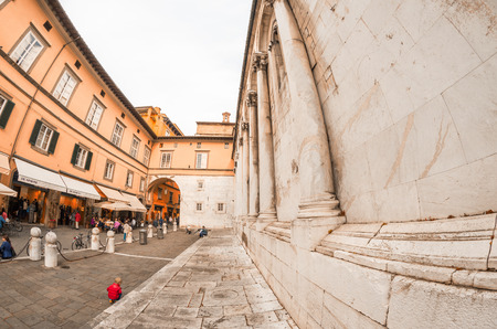san michele: LUCCA, ITALY - APRIL 18, 2015: Tourists and locals in Piazza San Michele. Lucca is one of the most visited town of Tuscany. Editorial