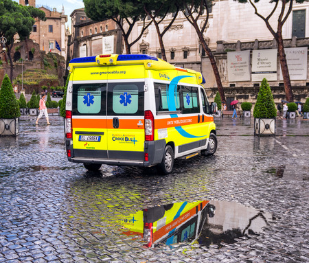 emergency case: ROME, MAY 20, 2014: Ambulance car parked in city street ready to operate in case of emergency.