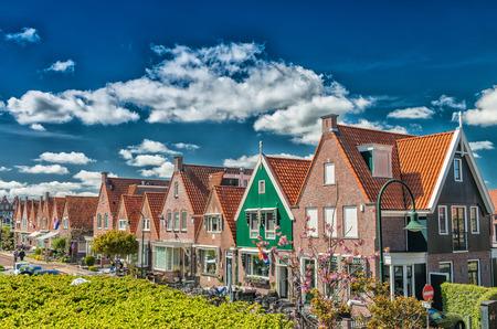 volendam: Volendam, Netherlands. Classic homes aligned along city street.