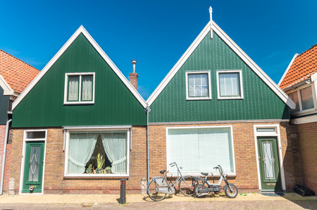 volendam: Volendam, Netherlands. Classic homes aligned along city street.