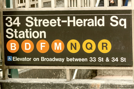 subway entrance: 34th Street and Herald Square subway entrance sign - New York City.