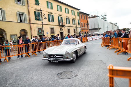 mille: PISA, ITALY - MAY 16, 2015: Mille miglia competition car along city streets. The old car parade takes place from 14th to 17th May 2015. Editorial