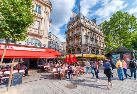 annually: PARIS - CIRCA JUNE 2014: Tourists visit the city. Paris attracts 30 million people annually.