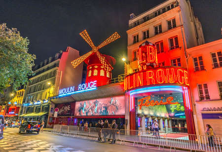 moulin: PARIS - JUNE 11: The Moulin Rouge by night, on June 11, 2014 in Paris, France. Moulin Rouge is a famous cabaret built in 1889, locating in the Paris red-light district of Pigalle. Editorial