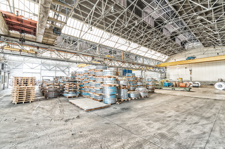 Warehouse of steel coils. Industrial environment and business concept.