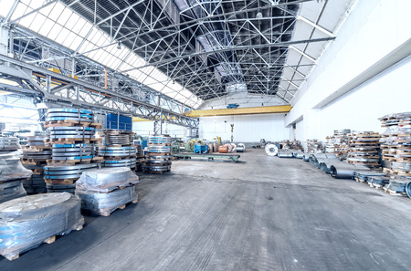 coils: Steel coils in a warehouse.