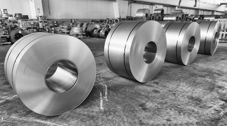 Steel coils inside industrial shed. Stock Photo