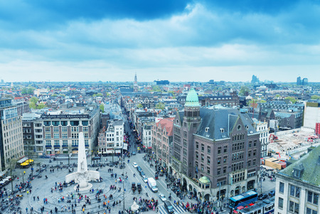 dam square: AMSTERDAM - APRIL 15, 2015: Aerial view of tourists in Dam Square. The city attracts 10 million people every year.