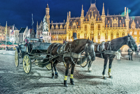 Horse-Drawn carriage in Bruges Market Square, Belgium. Stock Photo