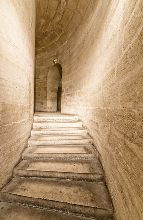Stairs inside a tunnel.