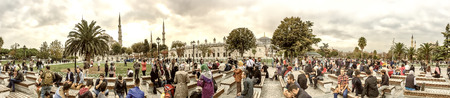 annually: ISTANBUL - SEPTEMBER 20, 2014: Tourists take a break in Sultanahmet Square. More than 10 milltion people visit the city annually.