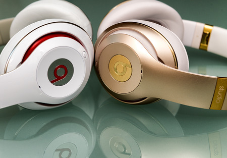 dr: PISA, ITALY - MAY 26, 2015: Beats studio wireless an wired headset. Beats by Dr. Dre has been acquired by Apple.