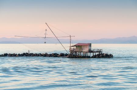 chinese fishing nets: Fishermans Net along the sea. Stock Photo
