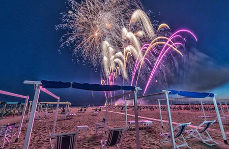 beach happy new year: Fireworks on a beautiful beach.