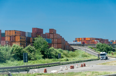 leghorn: LIVORNO, ITALY - JUNE 23, 2015: Containers near the city port. Port of Leghorn is the most important in Tuscany.