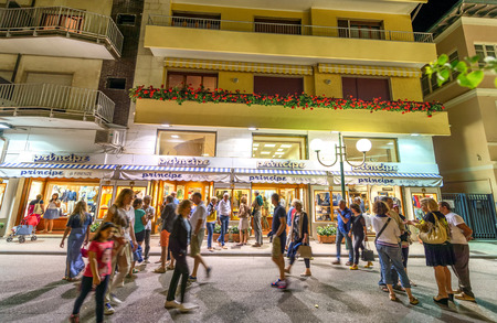forte: FORTE DEI MARMI, ITALY - JUNE 20, 2015: Tourists visit the city center at night. Forte di Marmi is one of the major touristic town along Tyrrhenian Sea.