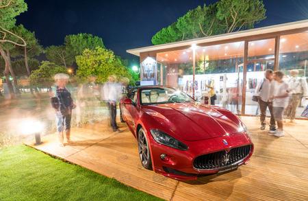 forte: FORTE DEI MARMI, ITALY - JUNE 20, 2015: Tourists visit Maserati store in city center. .